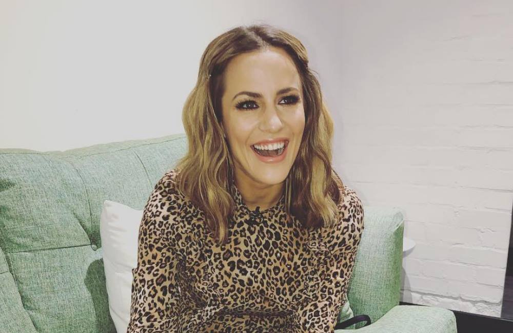 Caroline Flack and Andrew Brady over for good